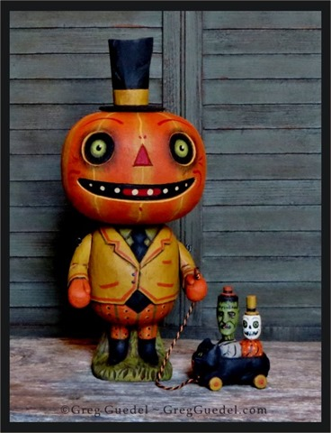Greg Guedel pumpkin man with pull toy 2015[3]